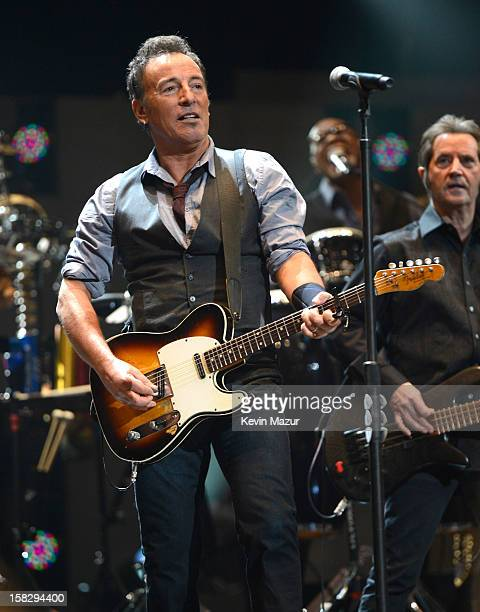 Bruce Springsteen and The E Street band perform at '121212' a concert benefiting The Robin Hood Relief Fund to aid the victims of Hurricane Sandy...