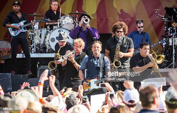 Bruce Springsteen and the E Street band with Tom Morello perform during the 2014 New Orleans Jazz Heritage Festival at Fair Grounds Race Course on...