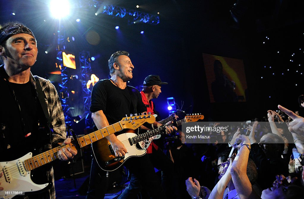 Bruce Springsteen and Tom Morello perform onstage at MusiCares Person Of The Year Honoring Bruce Springsteen at Los Angeles Convention Center on February 8, 2013 in Los Angeles, California.
