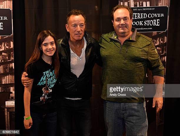 Bruce Springsteen fans Morgan Schwartz left and her father Ryan Schwartz have their picture taken with Springsteen at the Tattered Cover book store...
