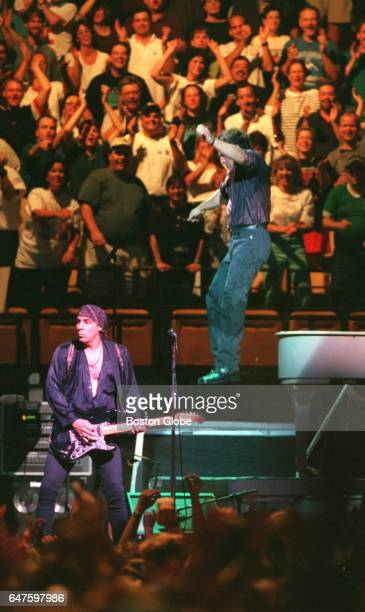 Bruce Springsteen jumps down from a piano during his performance at the Fleet Center in Boston on Aug 27 1999