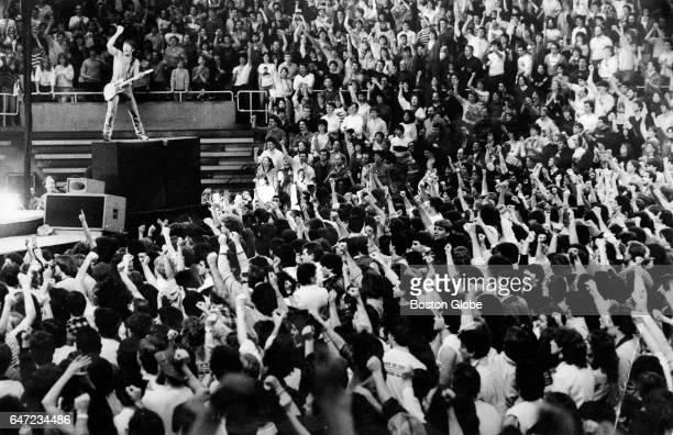 Bruce Springsteen leads the crowd in an encore from atop a speaker during a performance at the Providence Civic Center in Providence RI on Jan 24 1985