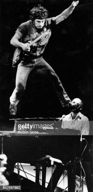 Bruce Springsteen leaps off the piano during his performance at the Providence Civic Center in Providence RI on Jan 24 1985