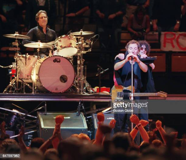 Bruce Springsteen left at microphone performs at the Fleet Center in Boston joined by guest Peter Wolf on Aug 27 1999
