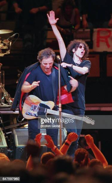 Bruce Springsteen left performs at the Fleet Center in Boston joined by guest Peter Wolf on Aug 27 1999