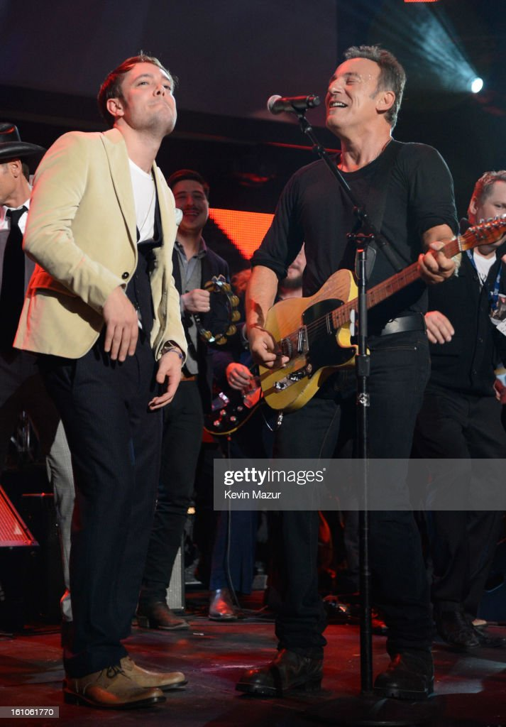 <a gi-track='captionPersonalityLinkClicked' href=/galleries/search?phrase=Bruce+Springsteen&family=editorial&specificpeople=123832 ng-click='$event.stopPropagation()'>Bruce Springsteen</a> performs onstage at MusiCares Person Of The Year Honoring <a gi-track='captionPersonalityLinkClicked' href=/galleries/search?phrase=Bruce+Springsteen&family=editorial&specificpeople=123832 ng-click='$event.stopPropagation()'>Bruce Springsteen</a> at Los Angeles Convention Center on February 8, 2013 in Los Angeles, California.