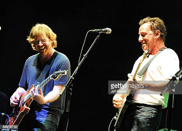 Bruce Springsteen performs with Trey Anastasio of Phish on stage during Bonnaroo 2009 on June 14 2009 in Manchester Tennessee
