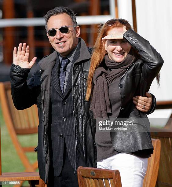 Bruce Springsteen waves after he and wife Patti Scialfa watch their daughter Jessica Springsteen compete in the show jumping event at the Royal...