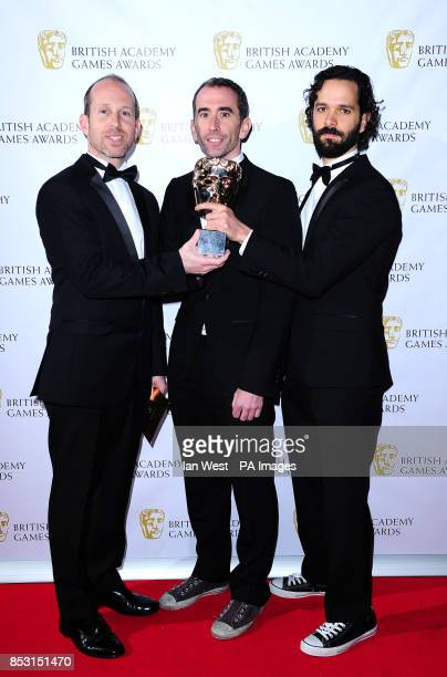 Bruce Straley and Neil Druckmann Development Team of Naughty Dog with the Best Game award for The Last Of Us at the British Academy Games Awards at...