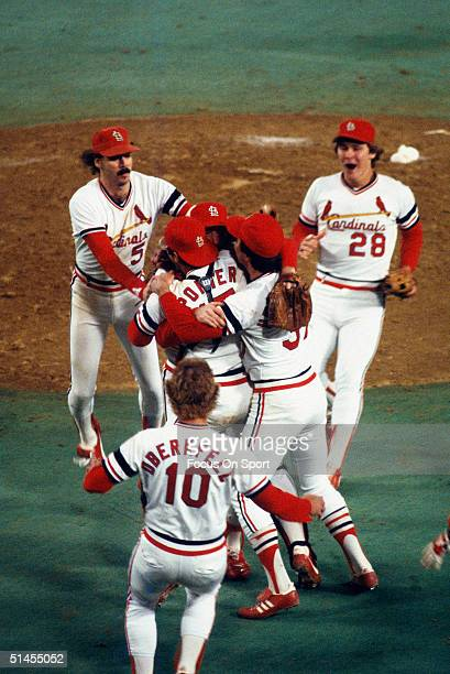 Bruce Sutter Darrell Porter and Keith Hernandez of the St Louis Cardinals greet teammates on the mound to celebrate winning the World Series against...