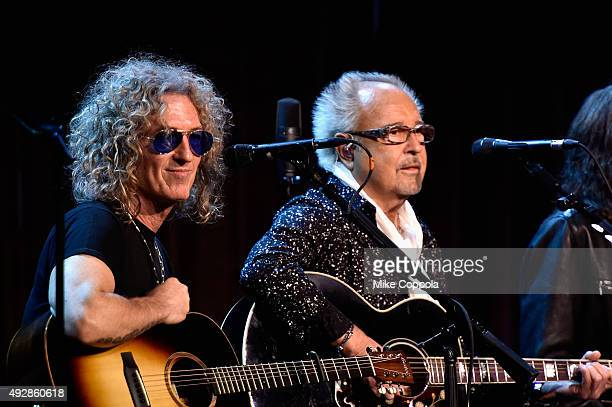 Bruce Watson and Mick Jones of Foreigner perform onstage at the TJ Martell 40th Anniversary NY Gala at Cipriani Wall Street on October 15 2015 in New...
