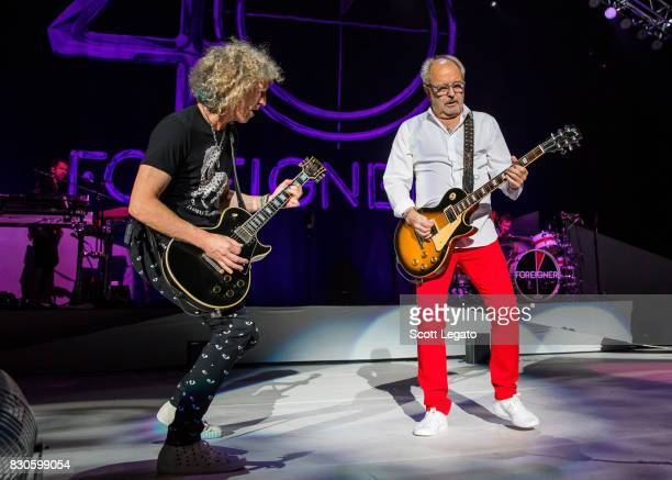 Bruce Watson and Mick Jones of the band Foreigner perform during their 40th Anniversary Tour at DTE Energy Music Theater on August 11 2017 in...