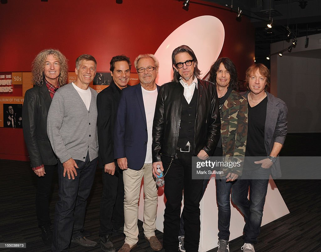Bruce Watson, Bob Santelli, Tom Gimbel, Mick Jones, Scott Goldman, Kelly Hansen and Jeff Pilson pose before Juke Box Heroes: An Evening With Foreigner at The GRAMMY Museum on October 30, 2012 in Los Angeles, California.
