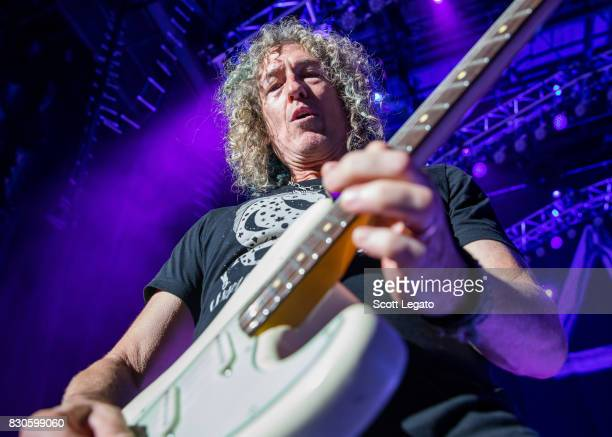 Bruce Watson of the band Foreigner performs during their 40th Anniversary Tour at DTE Energy Music Theater on August 11 2017 in Clarkston Michigan
