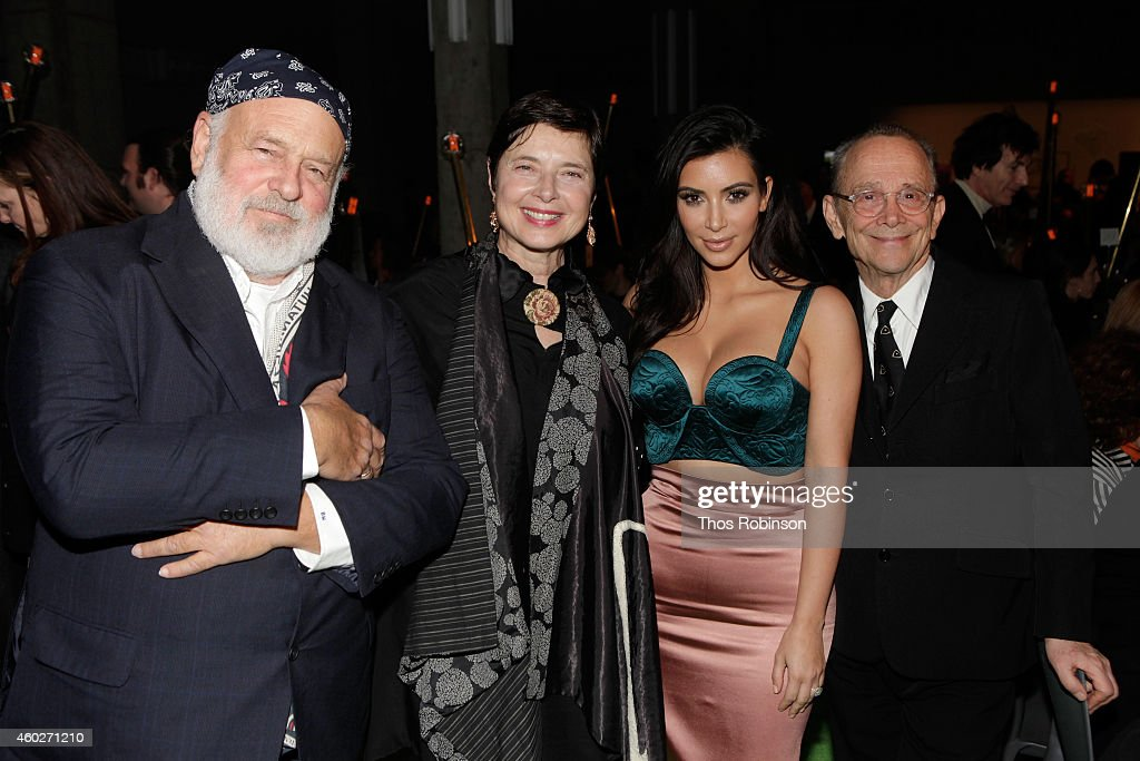 Bruce Weber, Isabella Rossellini, Kim Kardashian and Joel Grey attend the 19th Annual ACRIA Holiday Dinner at Skylight Modern on December 10, 2014 in New York City.