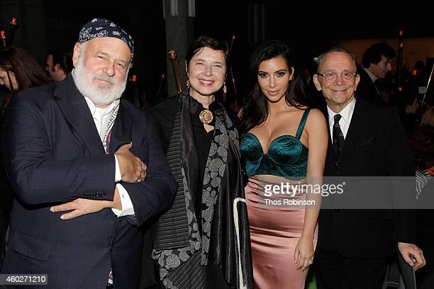 Bruce Weber Isabella Rossellini Kim Kardashian and Joel Grey attend the 19th Annual ACRIA Holiday Dinner at Skylight Modern on December 10 2014 in...