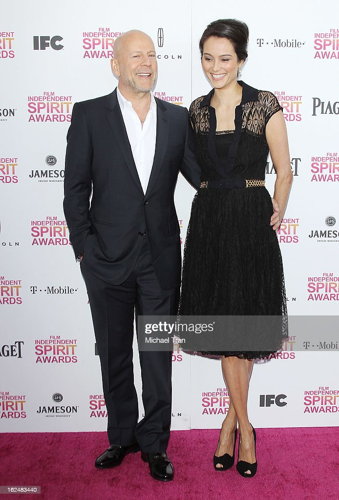 Bruce Willis (L) and Emma Heming arrive at the 2013 Film Independent Spirit Awards held on February 23, 2013 in Santa Monica, California.