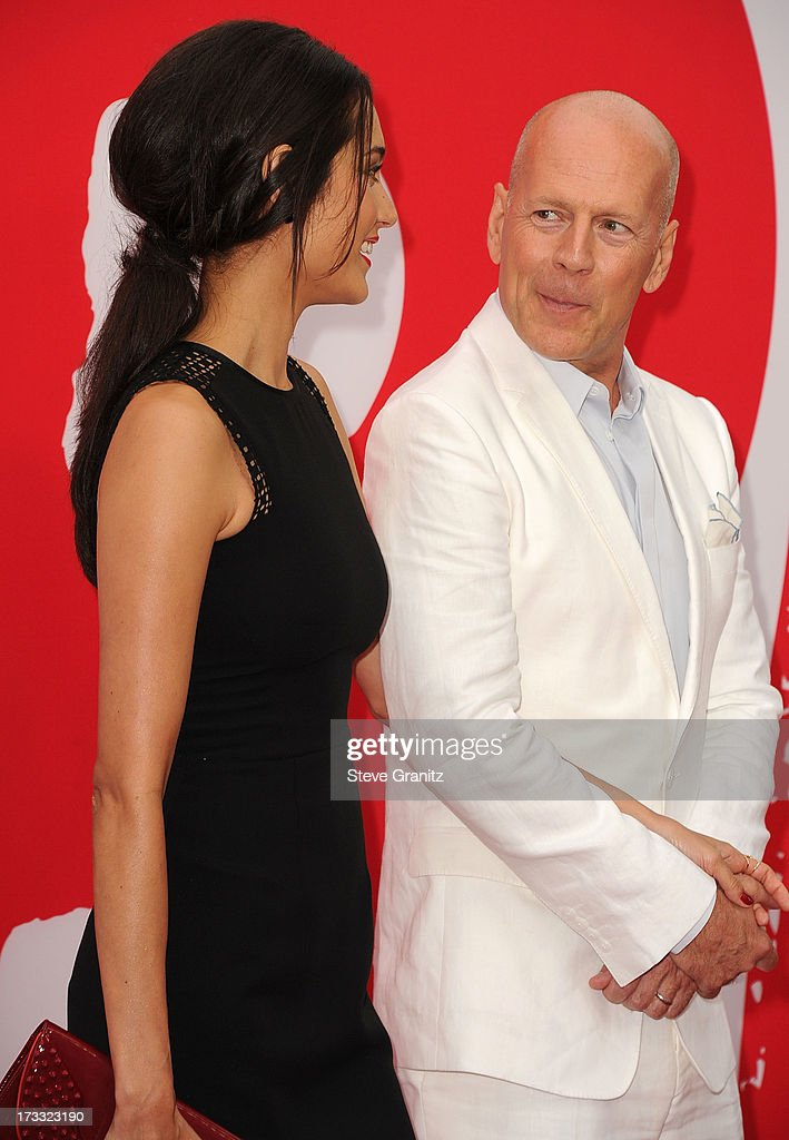 Bruce Willis and Emma Heming arrives at the 'RED 2' - Los Angeles Premiere at Westwood Village on July 11, 2013 in Los Angeles, California.
