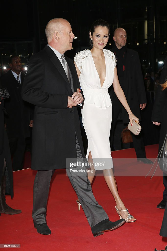 Bruce Willis and Emma Heming attend the German premiere of 'Die Hard - Ein Guter Tag Zum Sterben' at the cinestar Potsdamer Platz on February 4, 2013 in Berlin, Germany.