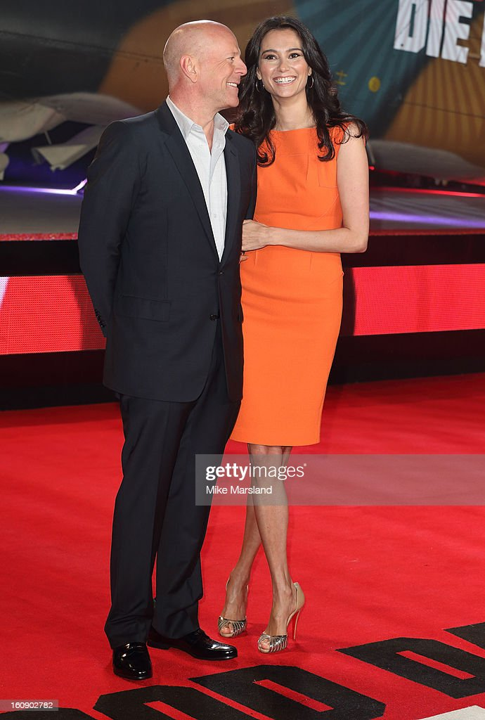 Bruce Willis and Emma Heming attend the UK premiere of 'A Good Day To Die Hard' at Empire Leicester Square on February 7, 2013 in London, England.