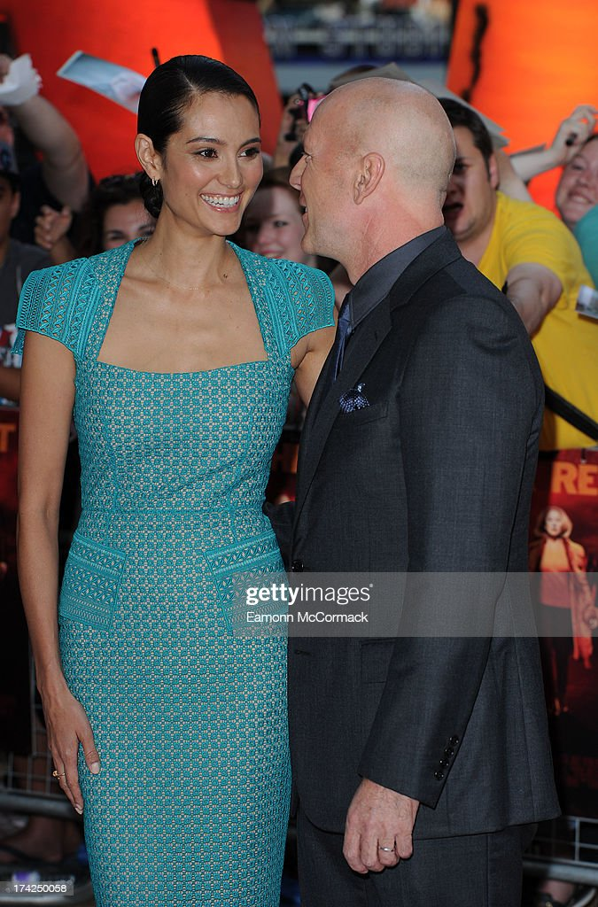 Bruce Willis and Emma Heming attends the European Premiere of 'Red 2' at Empire Leicester Square on July 22, 2013 in London, England.