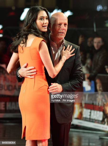 Bruce Willis and his wife Emma Heming arriving for the UK film premiere of A Good Day To Die Hard at the Empire Leicester Square in central London