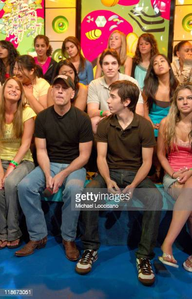 Bruce Willis and Justin Long during Bruce Willis Justin Long and a Performance by Huey on MTV's 'TRL' June 25 2007 at MTV Studios in New York City...