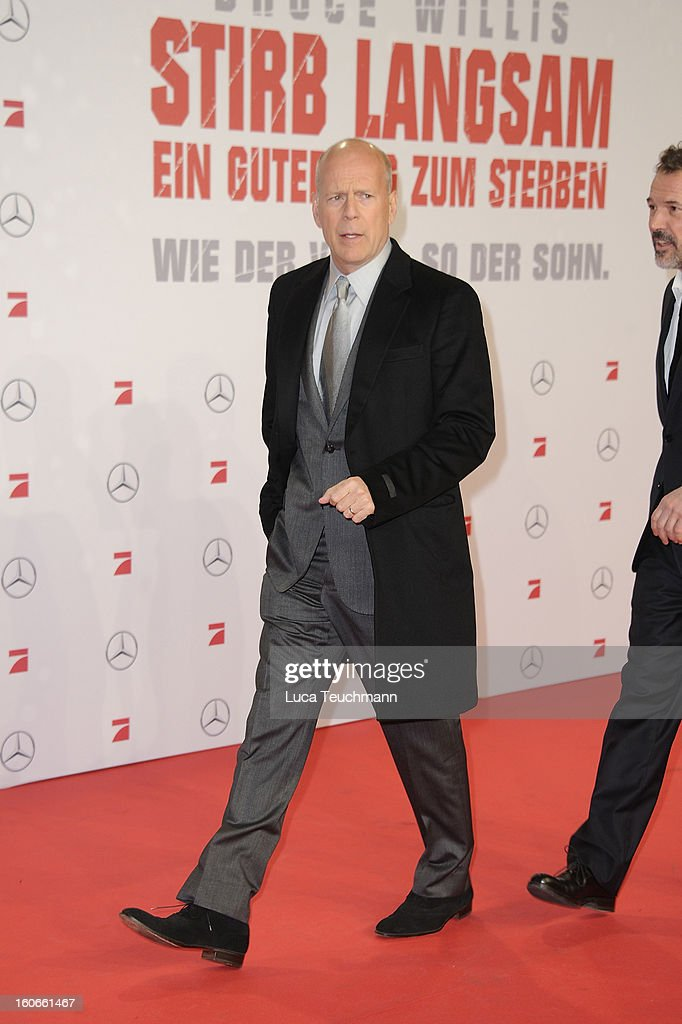 Bruce Willis attend the premiere of 'Die Hard - Ein Guter Tag Zum Sterben' at Sony Center on February 4, 2013 in Berlin, Germany.