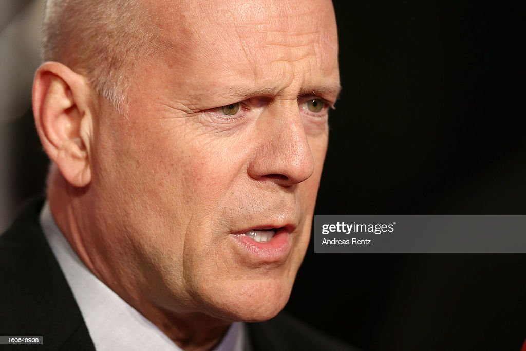 <a gi-track='captionPersonalityLinkClicked' href=/galleries/search?phrase=Bruce+Willis&family=editorial&specificpeople=202185 ng-click='$event.stopPropagation()'>Bruce Willis</a> attends 'Die Hard - Ein Guter Tag Zum Sterben' Germany Premiere at Cinestar Potsdamer Platz on February 4, 2013 in Berlin, Germany.