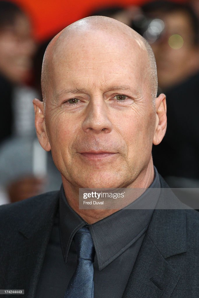 Bruce Willis attends the Red 2 Premiere at Empire Leicester Square on July 22, 2013 - bruce-willis-attends-the-red-2-premiere-at-empire-leicester-square-on-picture-id174244443