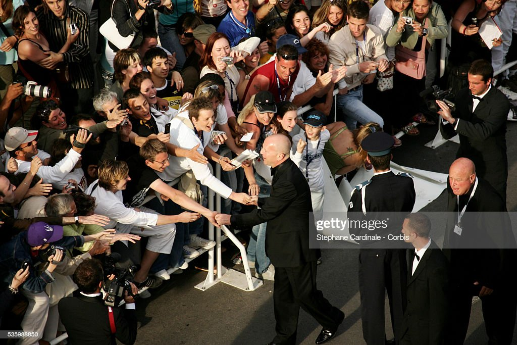 Bruce Willis greets fans at the premiere of 'Over the Hedge' during the 59th Cannes Film Festival.
