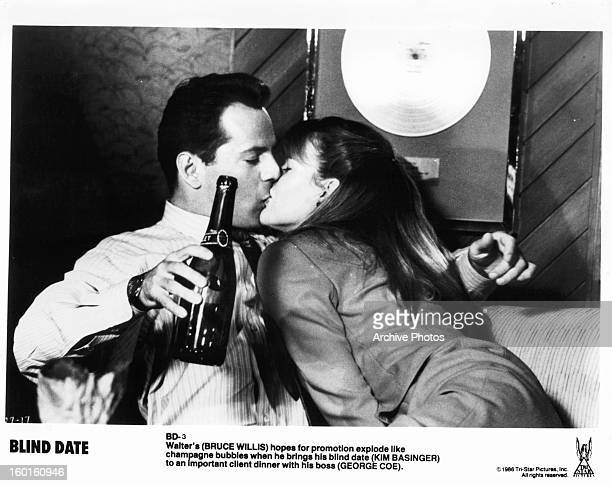 Bruce Willis is kissed by Kim Basinger in a scene from the film 'Blind Date' 1987