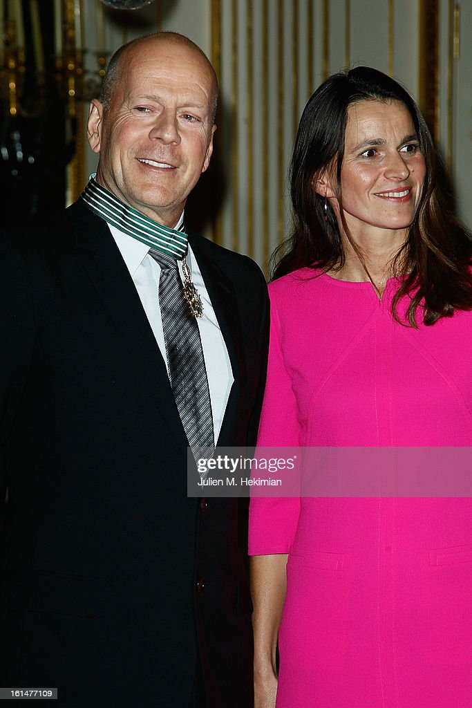 Bruce Willis poses after being awarded Commandeur dans l'Ordre des Arts et Lettres by French Minister for culture <a gi-track='captionPersonalityLinkClicked' href=/galleries/search?phrase=Aurelie+Filippetti&family=editorial&specificpeople=4273748 ng-click='$event.stopPropagation()'>Aurelie Filippetti</a> at Ministere de la Culture on February 11, 2013 in Paris, France.