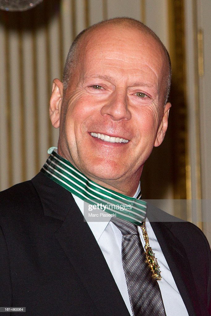 <a gi-track='captionPersonalityLinkClicked' href=/galleries/search?phrase=Bruce+Willis&family=editorial&specificpeople=202185 ng-click='$event.stopPropagation()'>Bruce Willis</a> poses after being awarded 'Commandeur dans l'Ordre des Arts et Lettres' at Ministere de la Culture on February 11, 2013 in Paris, France.