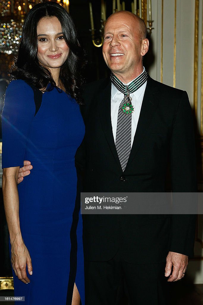 <a gi-track='captionPersonalityLinkClicked' href=/galleries/search?phrase=Bruce+Willis&family=editorial&specificpeople=202185 ng-click='$event.stopPropagation()'>Bruce Willis</a> poses with his wife <a gi-track='captionPersonalityLinkClicked' href=/galleries/search?phrase=Emma+Heming&family=editorial&specificpeople=734062 ng-click='$event.stopPropagation()'>Emma Heming</a>-Willis after being awarded Commandeur dans l'Ordre des Arts et Lettres at Ministere de la Culture on February 11, 2013 in Paris, France.