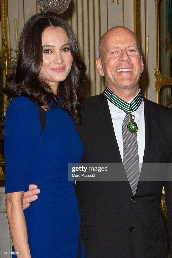 <a gi-track='captionPersonalityLinkClicked' href=/galleries/search?phrase=Bruce+Willis&family=editorial&specificpeople=202185 ng-click='$event.stopPropagation()'>Bruce Willis</a> poses with his wife <a gi-track='captionPersonalityLinkClicked' href=/galleries/search?phrase=Emma+Heming&family=editorial&specificpeople=734062 ng-click='$event.stopPropagation()'>Emma Heming</a>-Willis after being awarded 'Commandeur dans l'Ordre des Arts et Lettres' at Ministere de la Culture on February 11, 2013 in Paris, France.