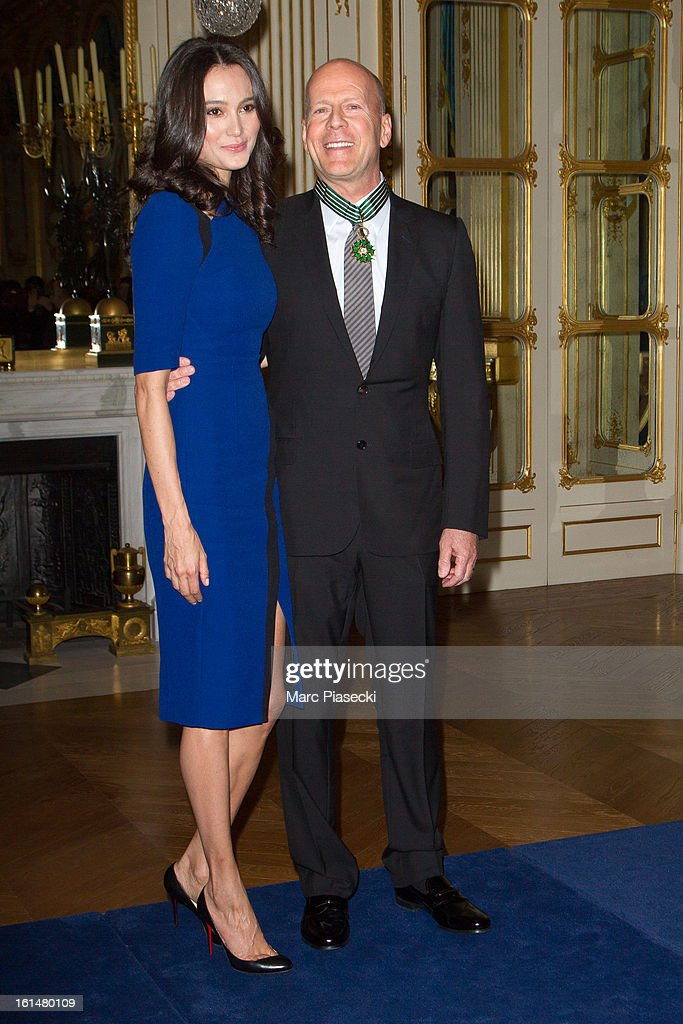 Bruce Willis poses with his wife Emma Heming-Willis after being awarded 'Commandeur dans l'Ordre des Arts et Lettres' at Ministere de la Culture on February 11, 2013 in Paris, France.