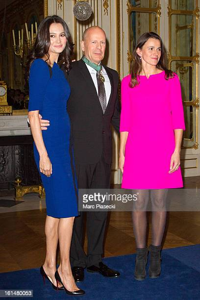 Bruce Willis poses with his wife Emma HemingWillis and French minister of Culture Aurelie Filipetti after being awarded 'Commandeur dans l'Ordre des...
