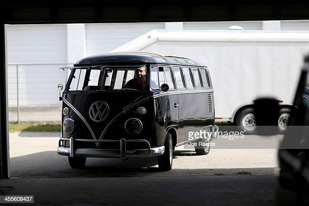 Bruce Wolczanski drives a 1955 Volkswagen OvalWindow bus in the parking lot at his McNab Foreign Car garage that specializes in restoring VW vehicles...