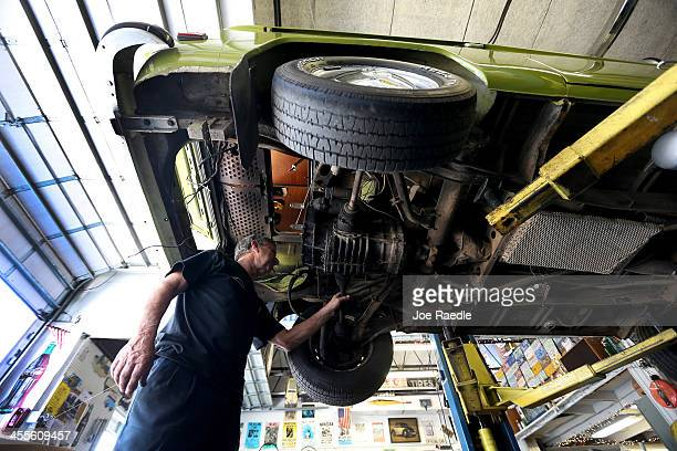 Bruce Wolczanski works on a 1976 Volkswagen bus camper at his McNab Foreign Car garage that specializes in restoring VW vehicles on December 12 2013...
