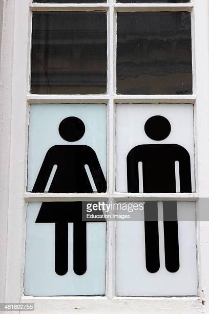 Bruges Belgium Flanders Europe Brugge Belgian male female toilet sign in black and white in window
