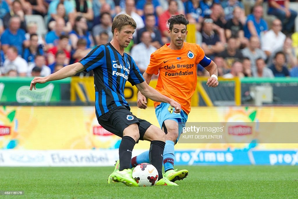 Bruges' Brandon Mechele (L) and Lierse's Hernan Losada vie for the ball during the Jupiler Pro League match between Club Brugge KV and Lierse, in Bruges, on August 3, 2014, on the second day of the Belgian football championship. AFP PHOTO / BELGA / KURT DESPLENTER