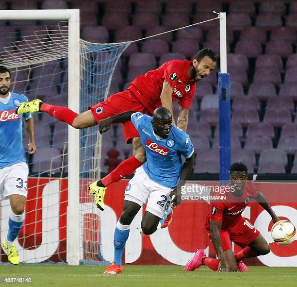 Bruges's forward from Brazil Leandro Pereira fights for the ball with Napoli's defender from France Kalidou Koulibaly during the UEFA Europa League...