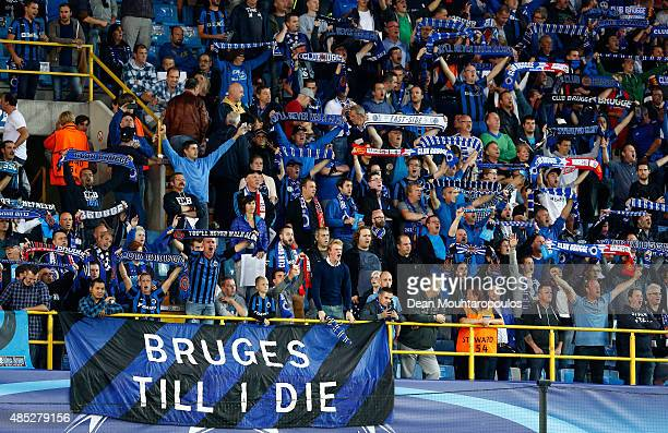 Brugge fans sing during the UEFA Champions League qualifying round play off 2nd leg match between Club Brugge and Manchester United held at Jan...
