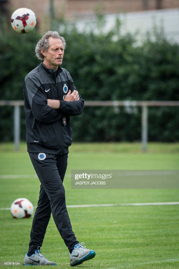 Brugge KV football team's Belgian head coach Michel Preud'homme directs a training session on July 30, 2014 in Brugge, a day ahead of the club's first leg match in the third qualifying round of the UEFA Champions League competition against Danish team Brondby IF. AFP PHOTO / BELGA PHOTO / JASPER JACOBS ** Belgium Out **