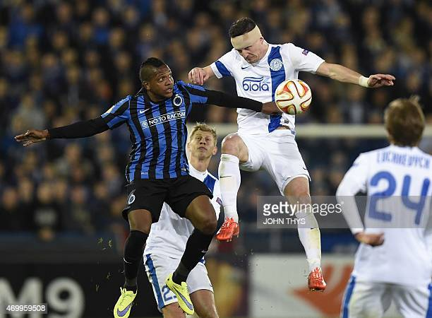 Brugge's Colombian forward Jose Izquierdo vies with Dnipro's midfielder Valeriy Fedorchuk during the UEFA Europa League quarterfinal football match...