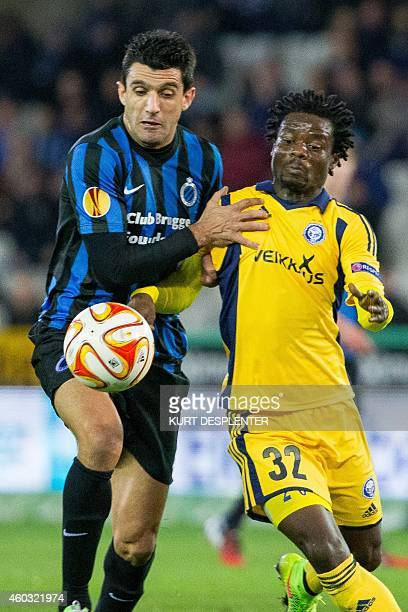 Brugge's Fernando Menegazzo and Helsinki's midfielder Anthony Annan vie for the ball during the UEFA Europa League group B football match between...