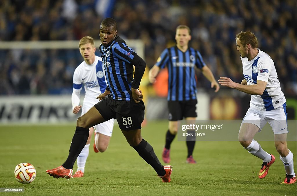 Brugge's forward Obbi Oulare (L) vies with Dnipro's midfielder <a gi-track='captionPersonalityLinkClicked' href=/galleries/search?phrase=Yevhen+Cheberyachko&family=editorial&specificpeople=8042109 ng-click='$event.stopPropagation()'>Yevhen Cheberyachko</a> (R) during the UEFA Europa League quarter-final football match between Club Brugge and Dnipro at Jan Breydel stadium in Bruges, on April 16, 2015.