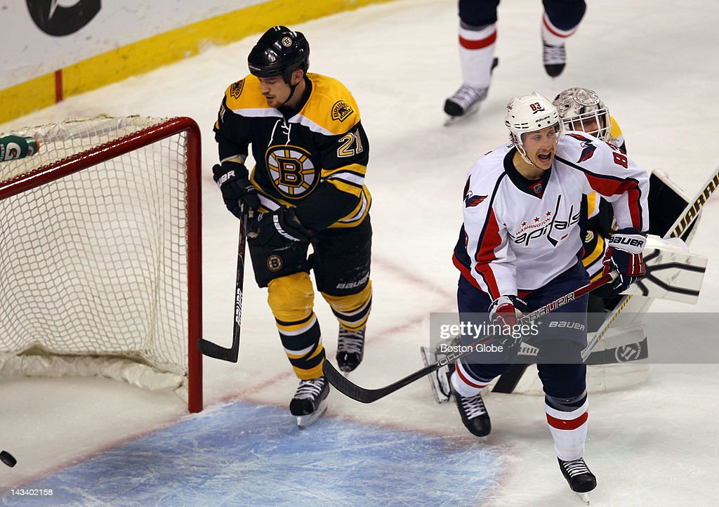 Bruins Andrew Ference looks at the first period goal scored by Capitals Matt Hendricks as Capitals Jay Beagle is joyous. The Boston Bruins and Washington Capitals met for game seven of the Stanley Cup Eastern Conference quarterfinals at TD Garden.