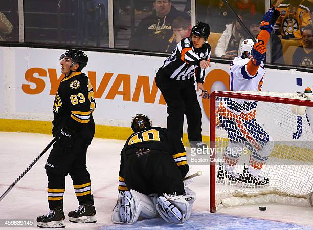 Bruins' Brad Marchand looks upset with himself after the goal by Islanders' Kyle Okposo went off his stick to tie the game 33 Islanders' John Tavares...